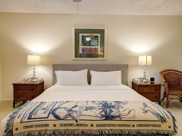 Relax in the master bedroom after a long day in the sun!